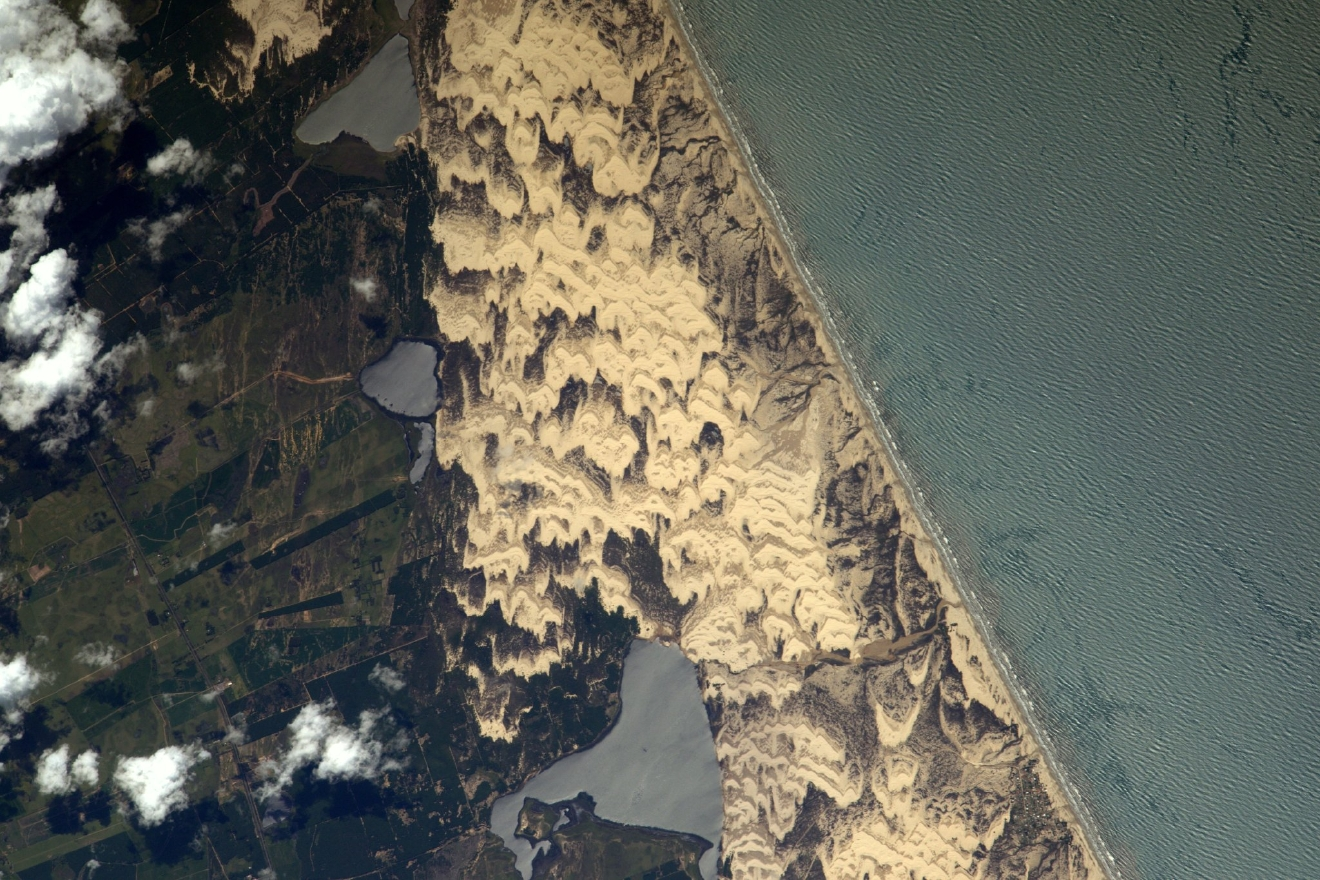 Sand dunes sculpted by the wind on the coast of #Brazil? (Photo & Caption: Thomas Pesquet // NASA)