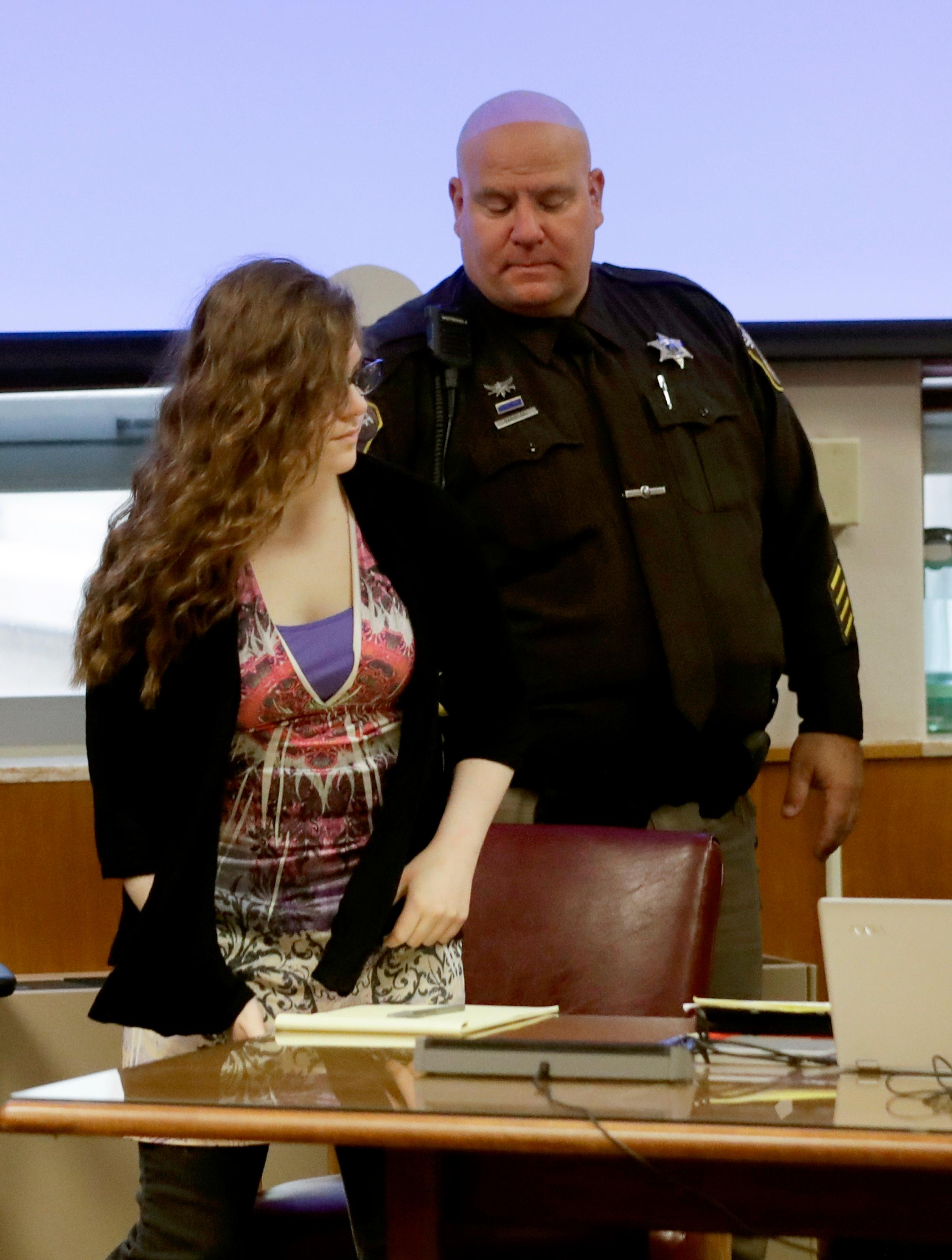 Anissa Weier is led into the courtroom for jury selection in the trial to determine 15-year-old Weier's competency at Waukesha County Courthouse Monday, Sept 11, 2017, in Waukesha, Wis. (AP Photo/Morry Gash, Pool)