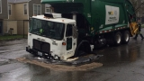 Recycling truck falls into W. Seattle sinkhole