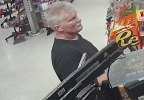 This surveillance image released by the Manitowoc Police Dept. shows a man who robbed a store in North Greenbush, N.Y., and is suspected of robbing a Manitowoc store at gunpoint.