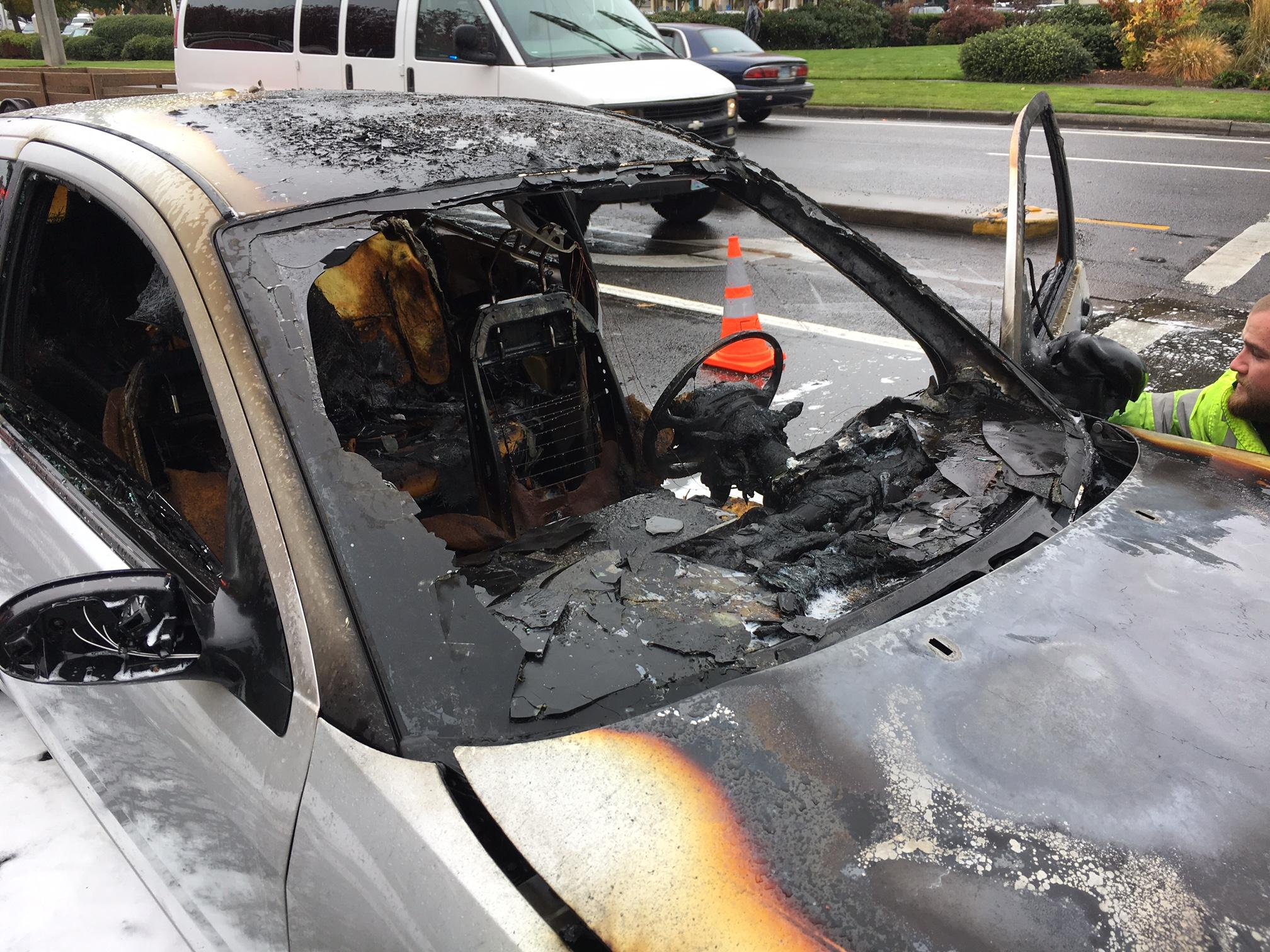 "Laura Hellman said she smelled smoke as she drove on Coburg Road. ""All of a sudden I saw a little puff of smoke coming out of the hood,"" she recalled. ""Then all of a sudden when I was stopped, it started to burst into flame. I grabbed my purse and got out of the car."" (SBG)"
