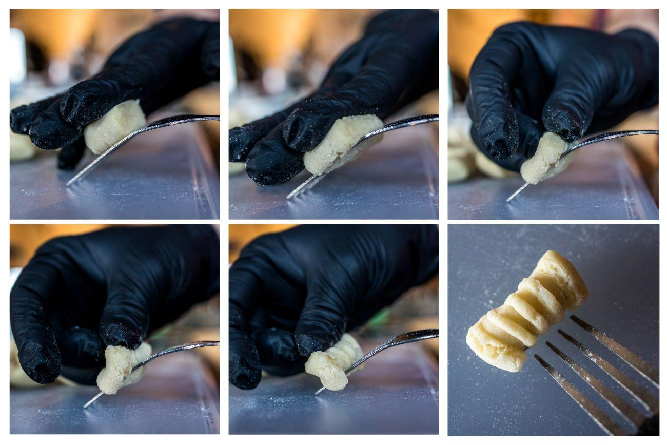 Take a single piece of gnocchi and press it flat against the backside of a fork. Then gently fold the top of the gnocchi over the bottom. / Image: Catherine Viox // Published: 4.4.20