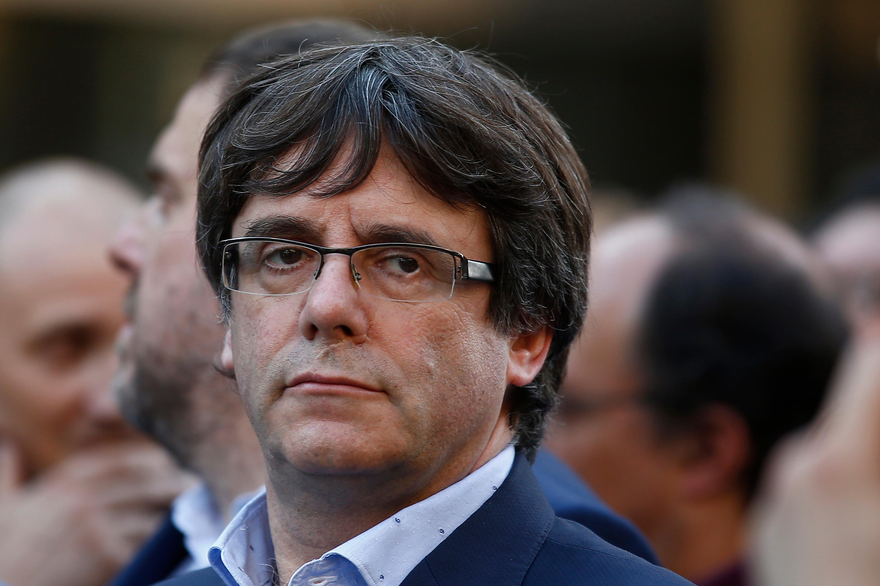 Catalan President Carles Puigdemont takes part at a march to protest against the National Court's decision to imprison civil society leaders, in Barcelona, Spain, Saturday, Oct. 21, 2017. The Spanish government moved decisively Saturday to use a previously untapped constitutional power so it can take control of Catalonia and derail the independence movement led by separatist politicians in the prosperous industrial region. AP Photo/Manu Fernandez)