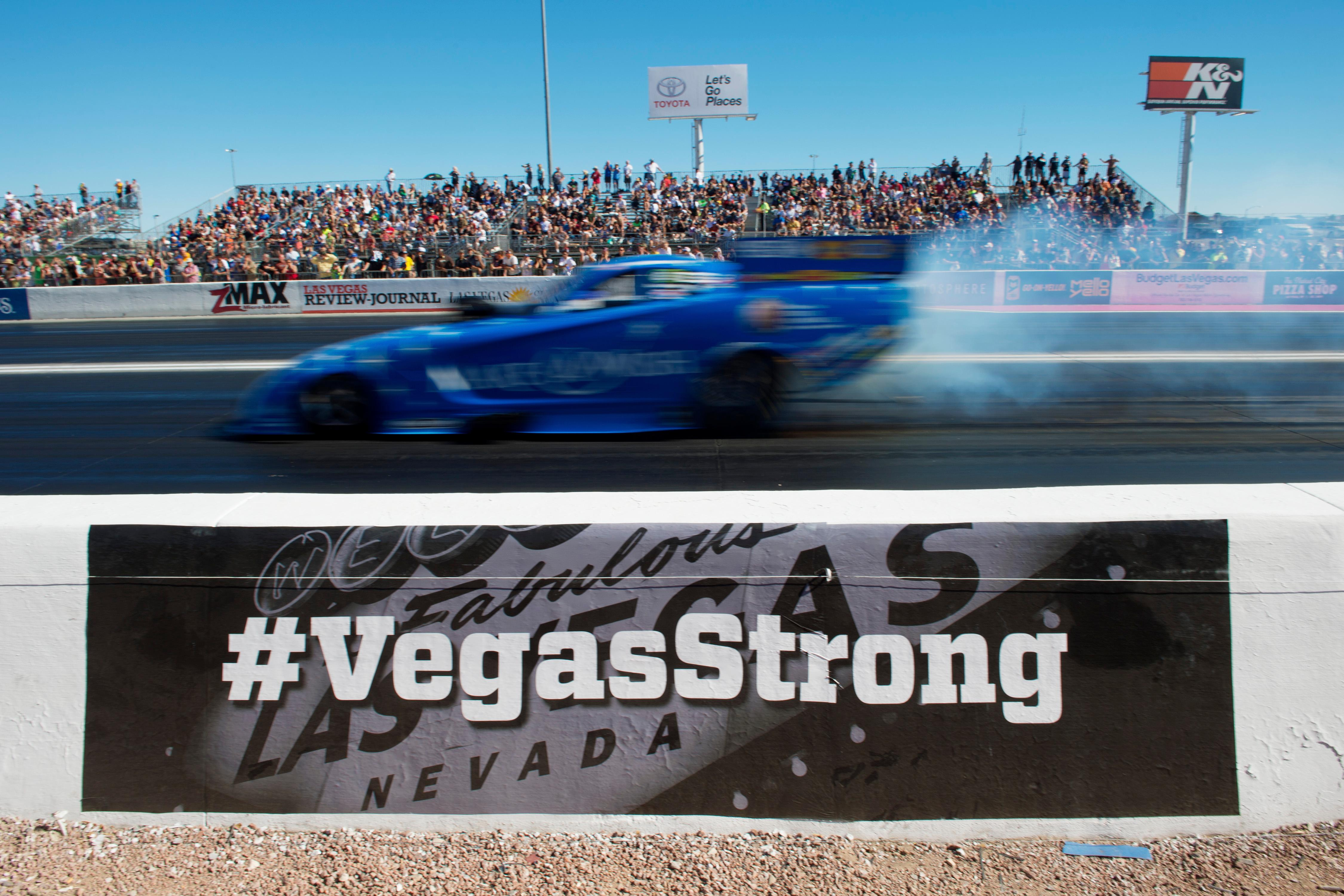 Funny Car driver Tommy Johnson passes a #VegasStrong message during the NHRA Toyota Nationals Sunday, October 29, 2017, at The Strip at the Las Vegas Motor Speedway. CREDIT: Sam Morris/Las Vegas News Bureau