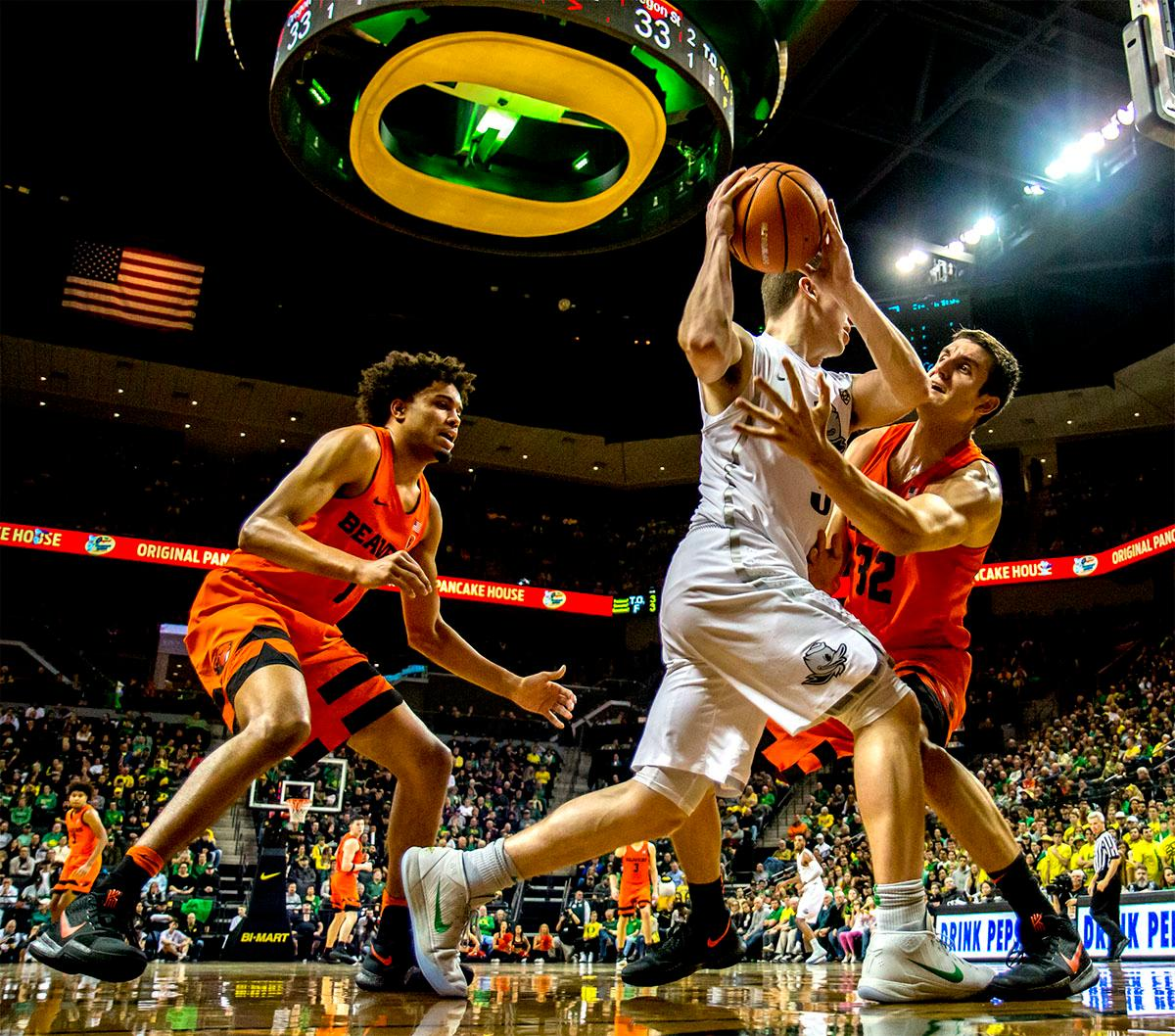The Beaver's Seth Berger (#32) attempts to steal the ball from the Duck's Payton Pritchard (#3). The Ducks defeated the Beavers in the civil war game, 66-57, at Matthew Knight Arena on Saturday night. Elijah Brown scored a game high of 20 points with 18 of the points coming in the first half, Paul White added 17 points. The Ducks are now 14-7 overall and 4-4 in conference play. The Ducks will next face California on Thursday Feb. 1 at 6:00 p.m. Photo by August Frank, Oregon News Lab